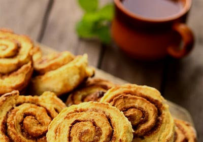 cinnamon rolls and cup of coffee