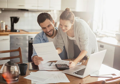 Couple looking at financial paperwork in kitchen