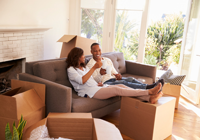 couple-on-couch-moving-boxes