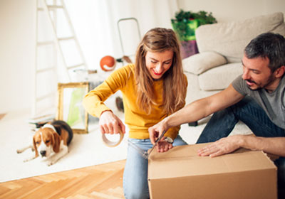 Couple packing moving box
