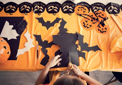 cutting-out-halloween-decorations