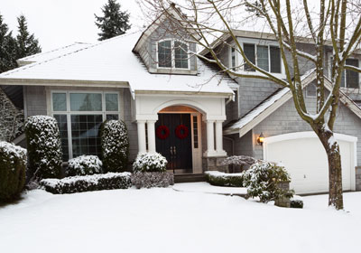 Grey house during the winter snow