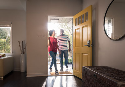 New home owners walking through front door