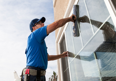 man-cleaning-home-windows