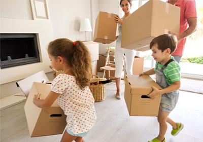 parents-2kids-carrying-moving-boxes