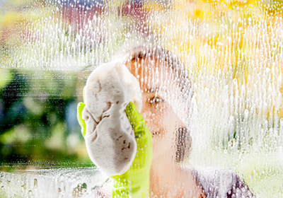 woman-cleaning-window
