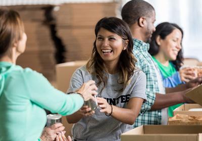 woman-volunteering-food-bank