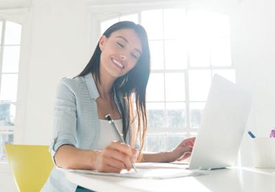 woman-writing-at-desk
