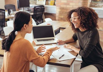 women-talking-paperwork