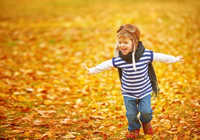 young-boy-running-in-leaves
