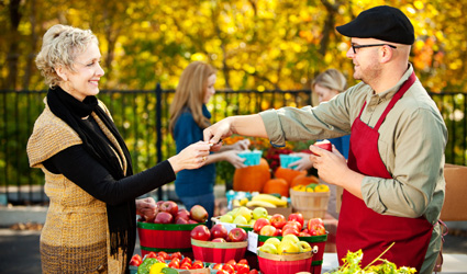 Woman shopping at farmers market in the fall