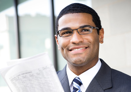 ReeceNichols Realtor reading newspaper