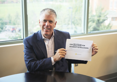 Mike Frazier, CEO of ReeceNichols Real Estate, signing the CEO Action for Diversity & Inclusion™.