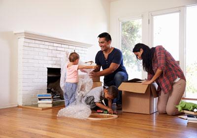 family-packing-living-room