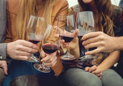 four-people-with-red-wine
