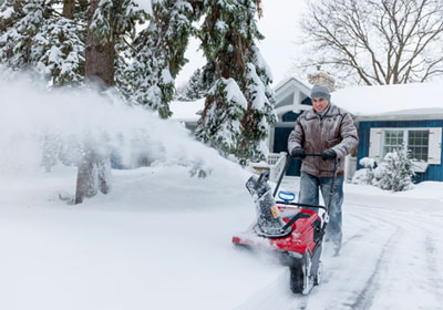 man-using-snow-blower
