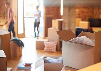 open-moving-box-in-apartment
