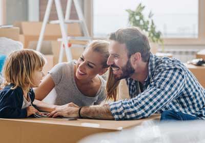 parents-child-moving-boxes