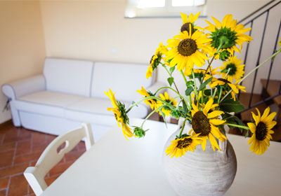 vase of sunflowers on table in living room