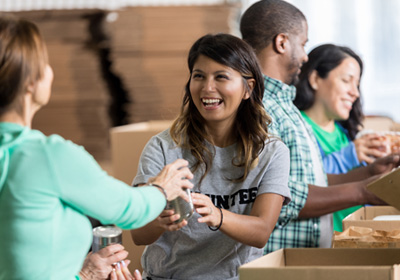 woman-volunteering-food-bank