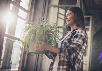 woman-with-indoor-plant
