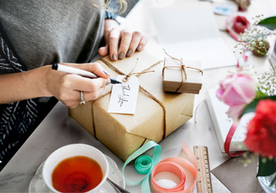 woman-wrapping-gift